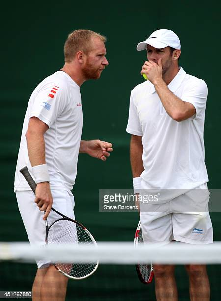 Lukas Dlouhy of Czech Republic and Paul Hanley of Australia and during their Gentlemen's Doubles first round match against Santiago Gonzalez of...