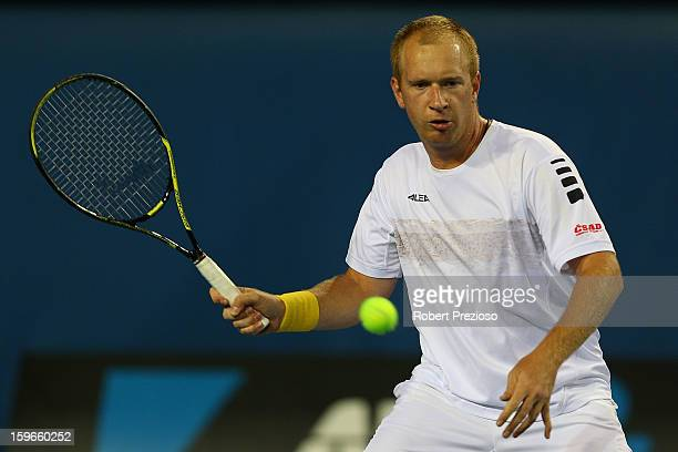 Lukas Dlouhy of Czech Republic plays a forehand with Daniele Bracciali of Italy during their third round doubles match against Alex Bolt of Australia...