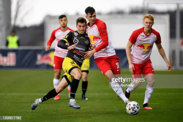 Lukas Fadinger of Lafnitz competes for the ball with Sebastian Aigner of Liefering during the 2. Liga match between FC Liefering and SV Licht-Loidl...
