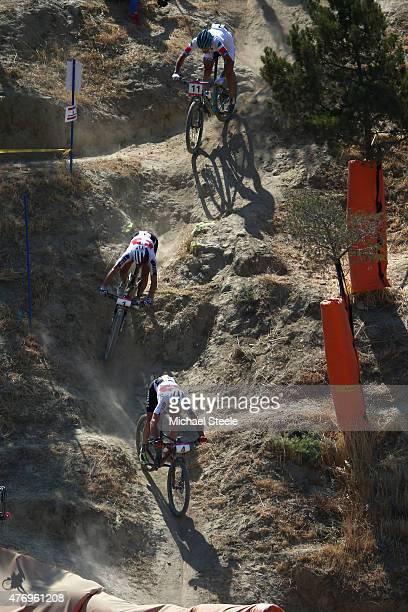 Lukas Fluckiger of Switzerland decends from Nino Schurter of Switzerland and Gerhard Kerschbaumer of Italy in the Mens' Crosscountry Mountain Bike...
