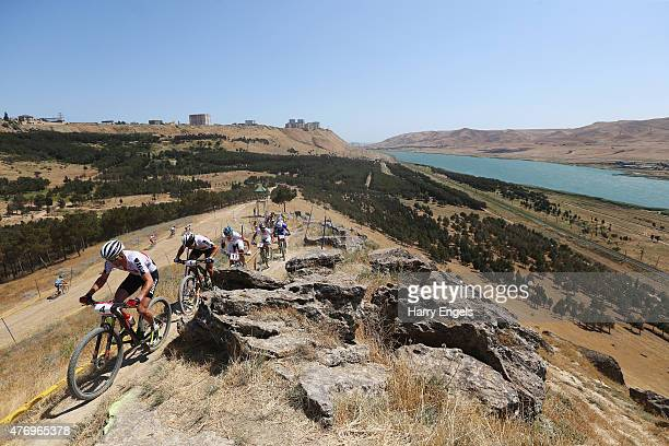 Lukas Fluckiger of Switzerland leads the pack up the climb during the Mens' Crosscountry Mountain Bike Cycling during day one of the Baku 2015...