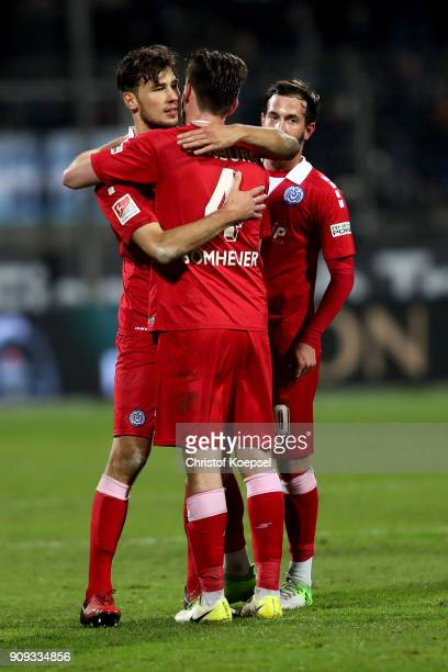 Lukas Froede and Dustin Bomheuer of Duisburg embrace after winning 20 the Second Bundesliga match between VfL Bochum 1848 and MSV Duisburg at Vonovia...