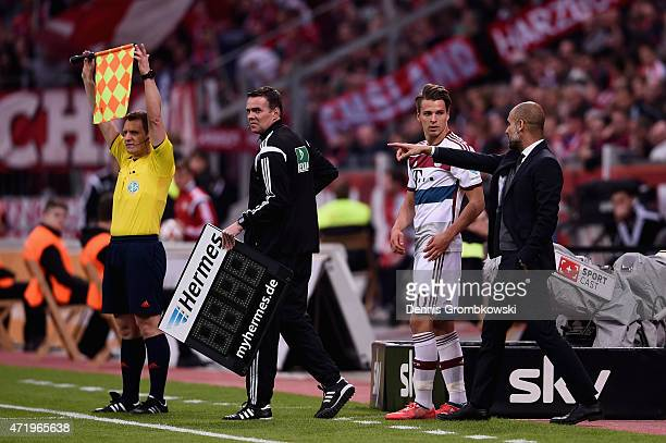 Lukas Goertler of FC Bayern Muenchen prepares for a substitution during the Bundesliga match between Bayer 04 Leverkusen and FC Bayern Muenchen at...
