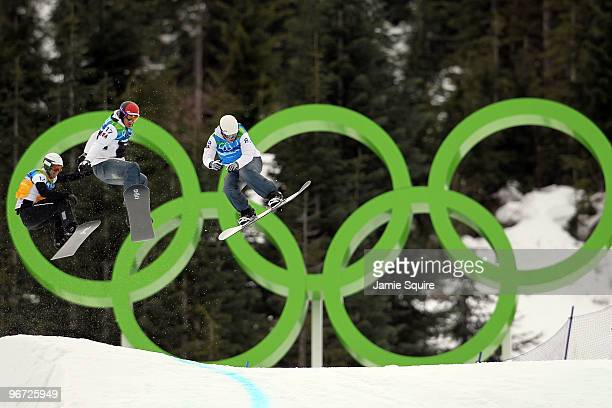 Lukas Gruener of Austria, Seth Wescott of the United States and Nate Holland of the United States compete against each other in semfinals heat during...