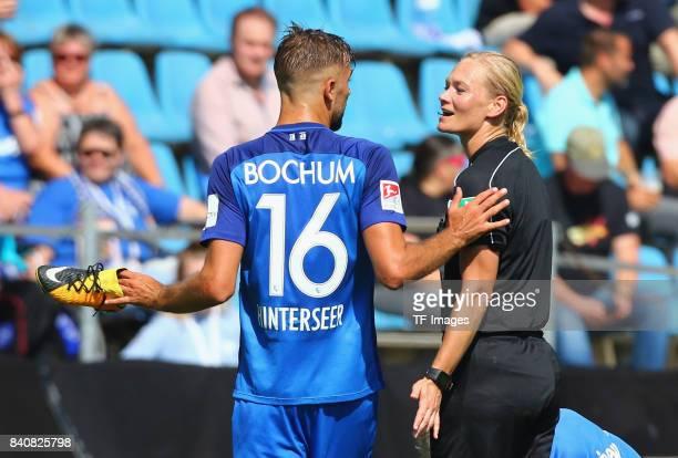 Lukas Hinterseer of Bochum speak with Bibiana Steinhaus during the Second Bundesliga match between VfL Bochum 1848 and SG Dynamo Dresden at Vonovia...