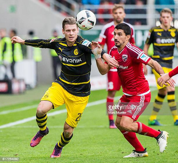 Lukas Hinterseer of FC Ingolstadt 04 challenges Lukasz Piszczek of Borussia Dortmund during a interview before the Bundesliga match between FC...