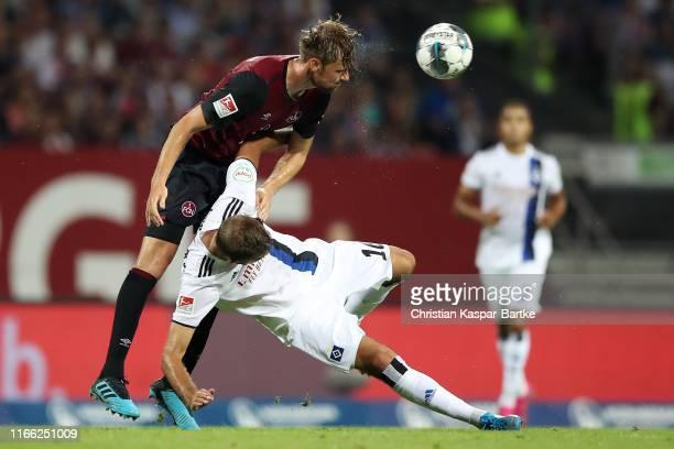 Lukas Hinterseer of Hamburg is challenged by Asger Sorensen of Nuernberg during the Second Bundesliga match between 1. FC Nuernberg and Hamburger SV...