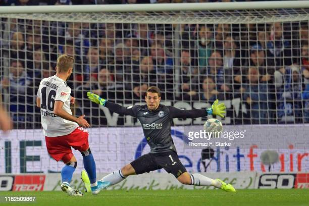 Lukas Hinterseer of Hamburg scores against Stefan Ortega Moreno of Bielefeld during the Second Bundesliga match between DSC Arminia Bielefeld and...