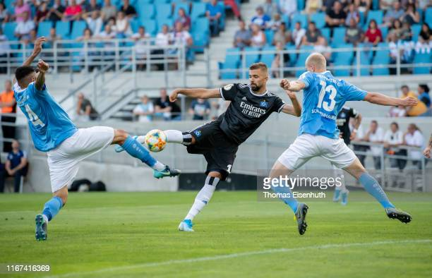 Lukas Hinterseer of Hamburg scores his team's first goal past Clemens Schoppenhauer and Georgi Sarmov of Chemnitz during the DFB Cup first round...