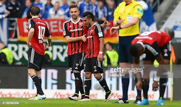 Lukas Hinterseer of Ingolstadt celebrates after scoring his team's second goal during the Bundesliga match between FC Ingolstadt and FC Schalke 04 at...