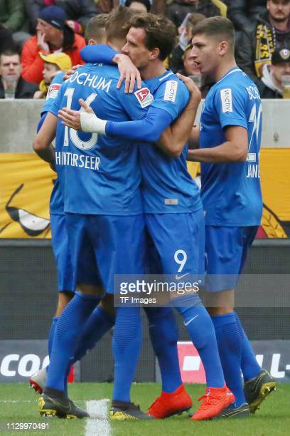 Lukas Hinterseer of VfL Bochum 1848 celebrates after scoring his team's first goal with team mates during the second Bundesliga match between Dynamo...
