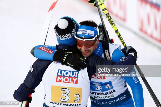 Lukas Hofer of Italy celebrates Dominik Windisch of Italy celebrates during the IBU Biathlon World Championships Men's and Women's Mixed Relay on...