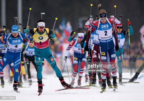 Lukas Hofer of Italy Martin Fourcade auof France and Johannes Thingnes Boe of Norway in action during the men's mass start event of the Biathlon...