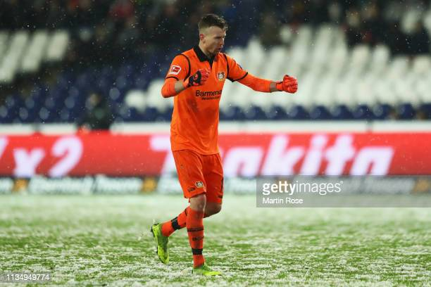 Lukas Hradecky of Bayer 04 Leverkusen celebrates his teams third goal of the game during the Bundesliga match between Hannover 96 and Bayer 04...