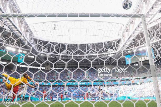 Lukas Hradecky of Finland fails to save Russia's first goal scored by Aleksei Miranchuk during the UEFA Euro 2020 Championship Group B match between...