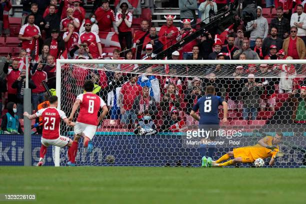 Lukas Hradecky of Finland saves a penalty taken by Pierre-Emile Hojbjerg of Denmark during the UEFA Euro 2020 Championship Group B match between...