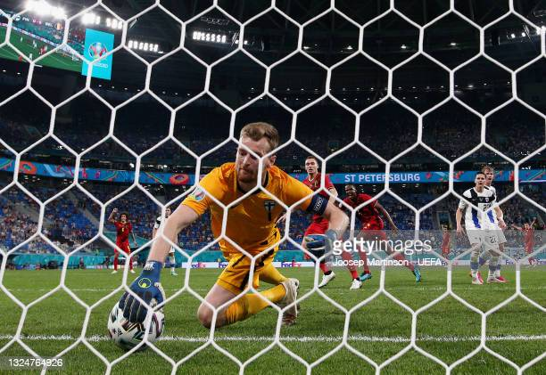 Lukas Hradecky of Finland scores an own goal, Belgium's first goal, as he attempts to save from Thomas Vermaelen of Belgium during the UEFA Euro 2020...