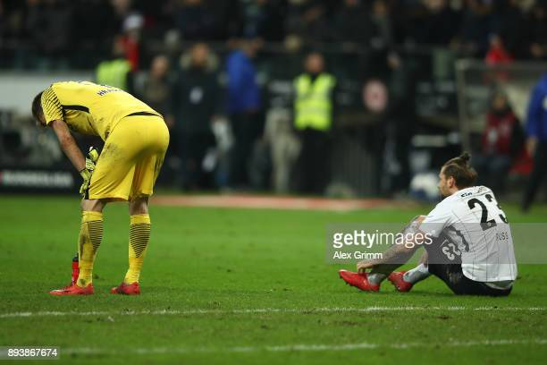 Lukas Hradecky of Frankfurt and Marco Russ of Frankfurt dejected after the Bundesliga match between Eintracht Frankfurt and FC Schalke 04 at...