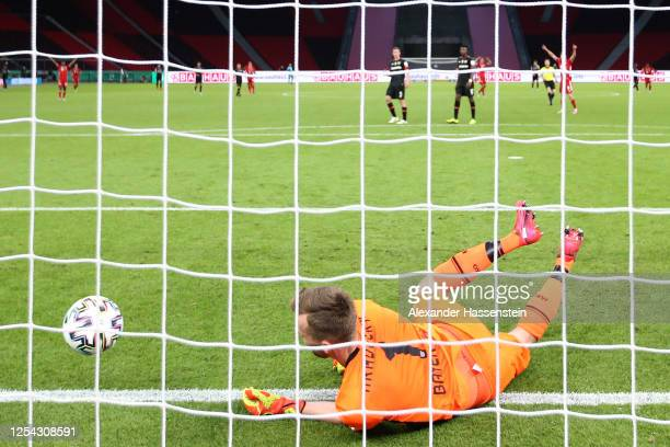 Lukas Hradecky of Leverkusen receives the 3rd goal during the DFB Cup final match between Bayer 04 Leverkusen and FC Bayern Muenchen at...