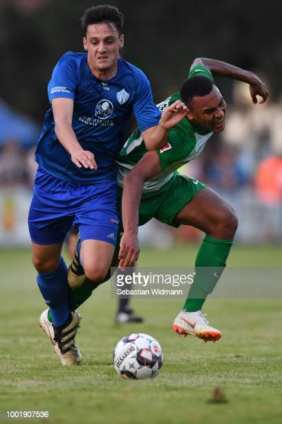 Lukas Ilic of Olching and Maurice Malone of Augsburg compete for the ball during the preseason friendly match between SC Olching and FC Augsburg on...