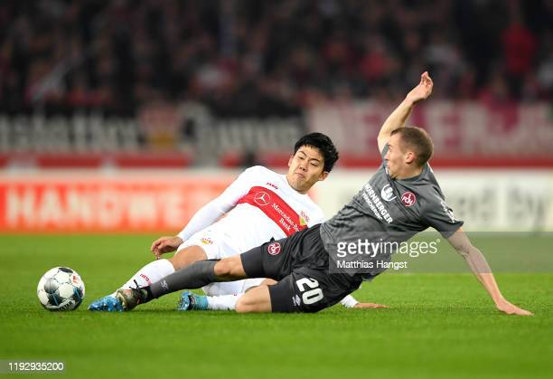 Lukas Jager of FC Nurnberg tackles Wataru Endo of VfB Stuttgart during the Second Bundesliga match between VfB Stuttgart and 1. FC Nürnberg at...