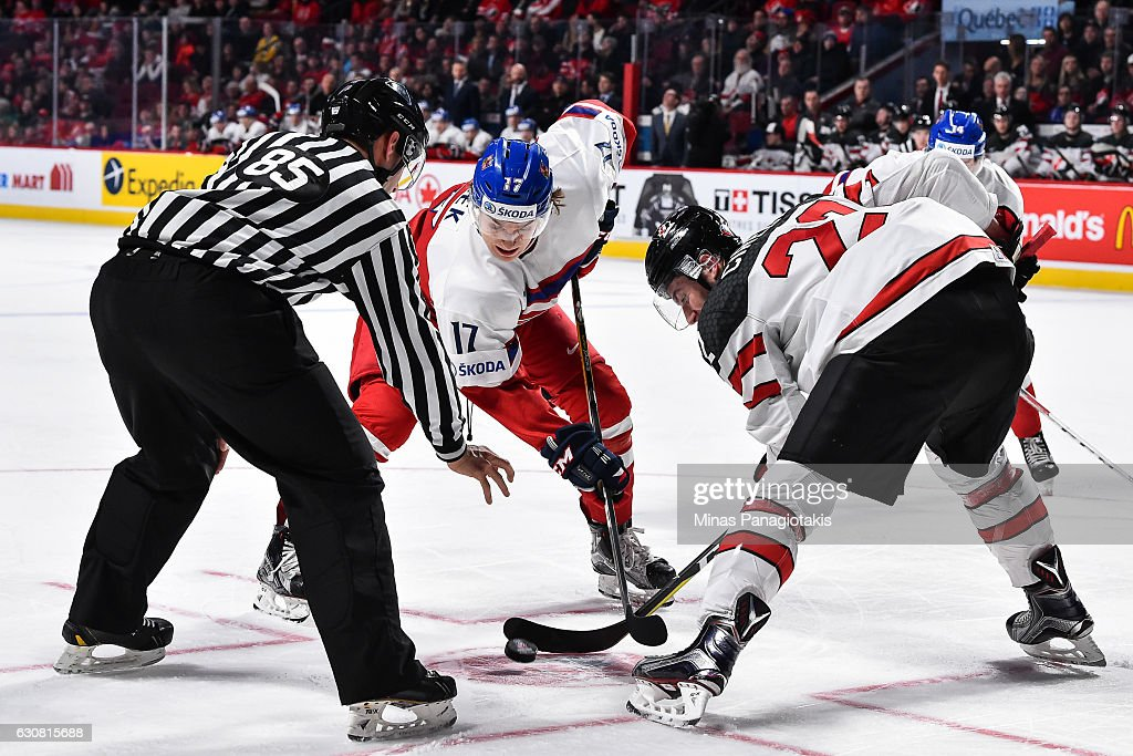 Lukas Jasek #17 of Team Czech Republic and Anthony Cirelli #22 of Team Canada face-off during the 2017 IIHF World Junior Championship quarterfinal game at the Bell Centre on January 2, 2017 in Montreal, Quebec, Canada.