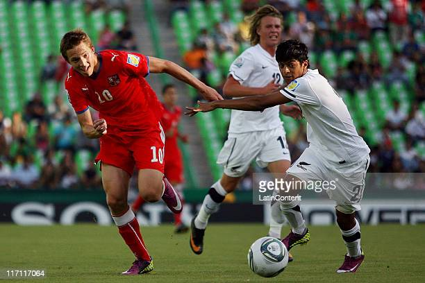Lukas Julis of Czech Republic struggles for the ball with Harshae Raniga of New Zealand during a match as part of the FIFA U17 World Cup Mexico...