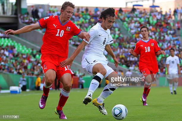 Lukas Julis of Czech Republic struggles for the ball with Reece Lambert of New Zealand during a match as part of the FIFA U17 World Cup Mexico 2011...