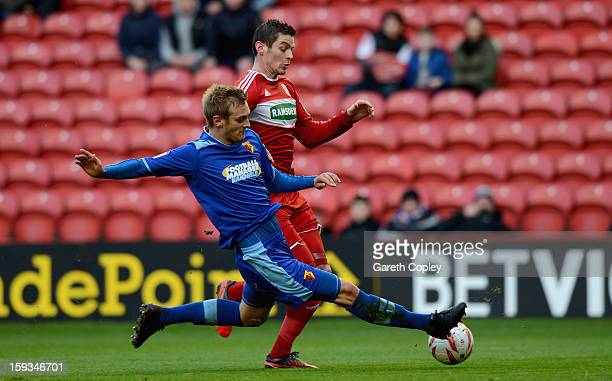 Lukas Jutiewicz of Middlesborough is tackled by Joel Ekstrand of Watford during the npower Championship match between Middlesbrough and Watford at...