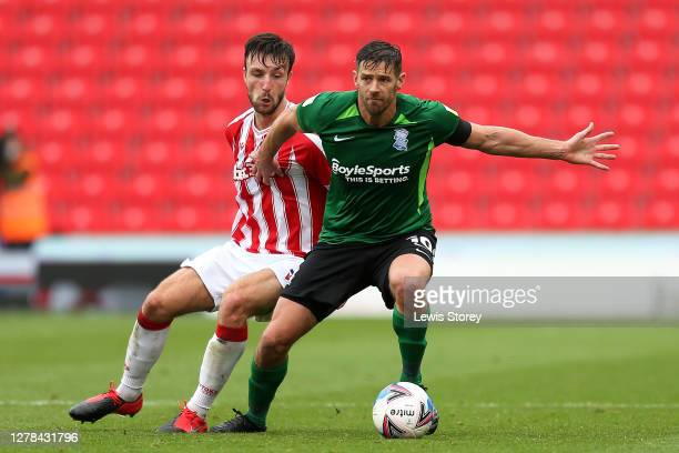 Lukas Jutkiewicz of Birmingham City battles for possession with Morgan Fox of Stoke City during the Sky Bet Championship match between Stoke City and...