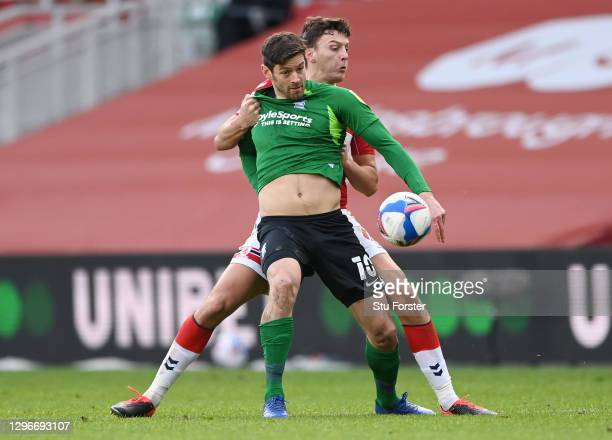 Lukas Jutkiewicz of Birmingham City is challenged by Dael Fry of Middlesborough during the Sky Bet Championship match between Middlesbrough and...