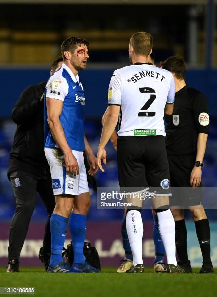 Lukas Jutkiewicz of Birmingham City is seen with a cut on his face after a challenge with Ryan Bennett of Swansea City during the Sky Bet...