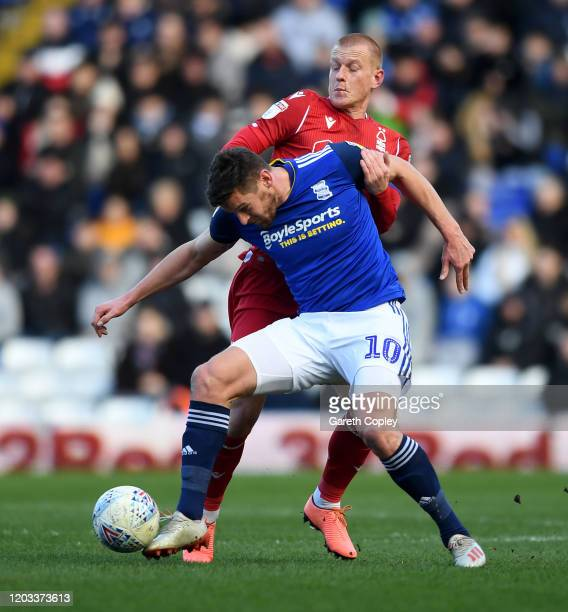 Lukas Jutkiewicz of Birmingham City is tackled by Ben Watson of Nottingham Forest during the Sky Bet Championship match between Birmingham City and...