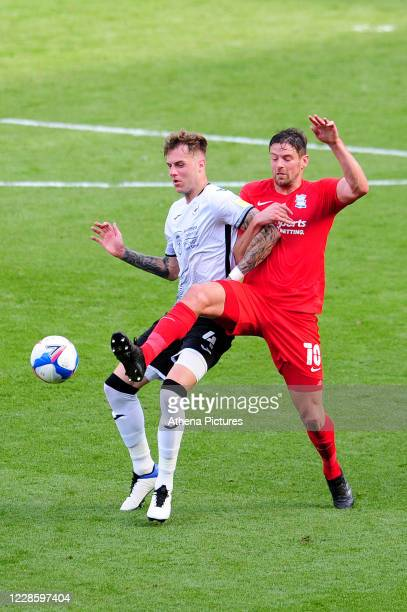 Lukas Jutkiewicz of Birmingham City vies for possession with Joe Rodon of Swansea City during the Sky Bet Championship match between Swansea City and...