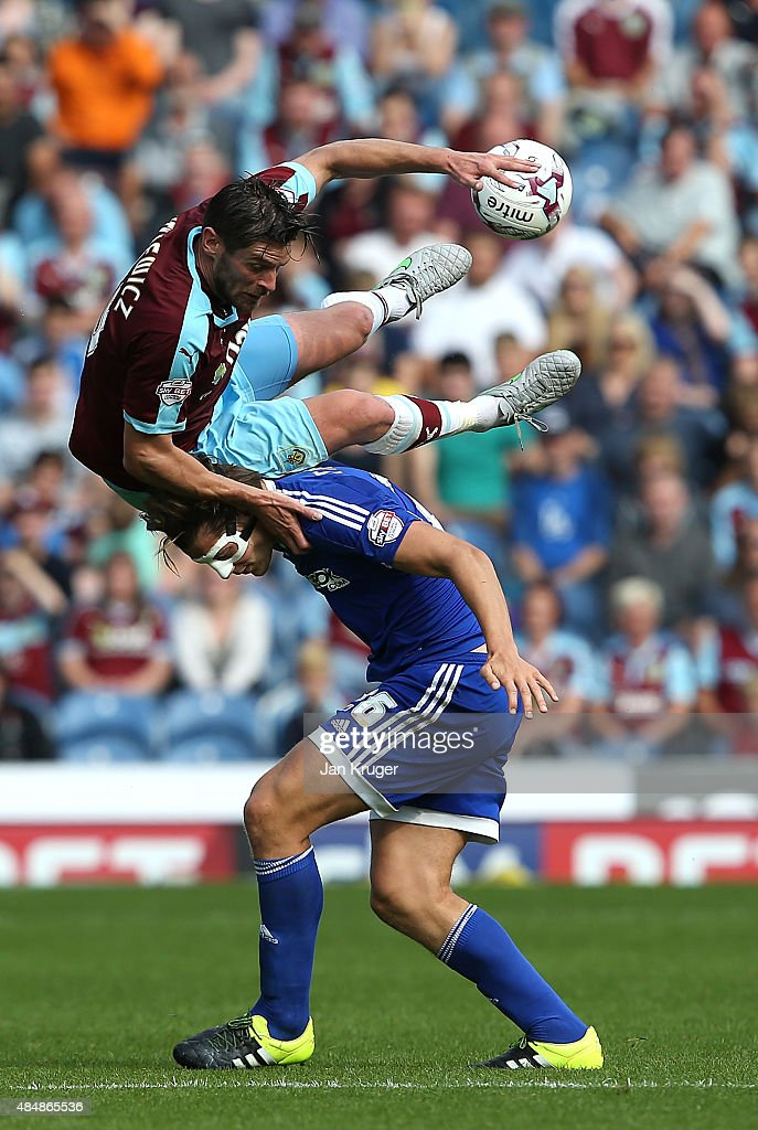 Lukas Jutkiewicz of Burnley clashes with James Tarkowski of Brentford during the Sky Bet Championship match between Burnley and Brentford at Turf Moor on August 22, 2015 in Burnley, England.