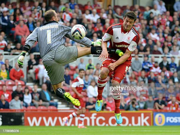 Lukas Jutkiewicz of Middlesbrough takes the ball past Ian Dunbavin of Accrinton Stanley to score the opening goal during the Capital One Cup First...