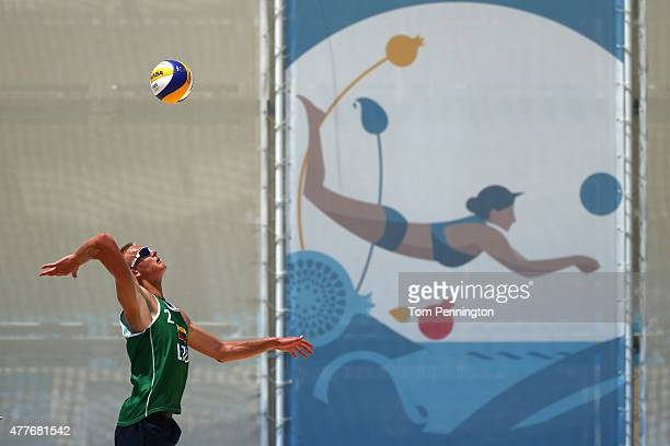 Lukas Kazdailis of Lithuainia serves against Morten Kvamsdal and Oeivind Hordvik of Norway in the Men's Beach Volleyball Preliminary match during day...