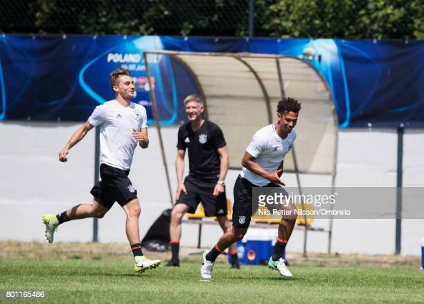 Lukas Klünter and Thilo Kehrer of Germany during the German U21 national team training session at Official Training Ground Wielczka on June 26 2017...