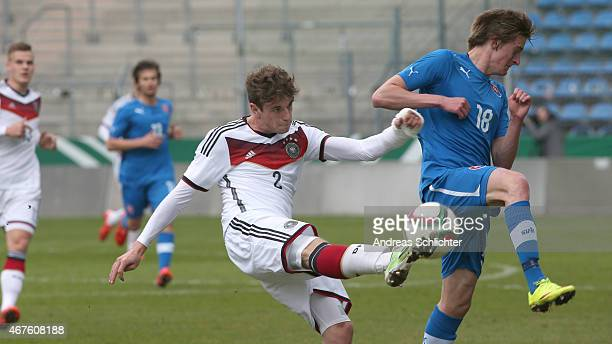 Lukas Klünter of Germany challenges Robert Polievka of Slovakia during the UEFA Under19 Elite Round match between U19 Germany and U19 Slovakia at...