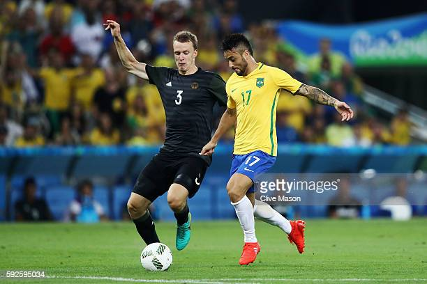 Lukas Klostermann of Germany and Felipe Anderson of Brazil in action during the Men's Football Final between Brazil and Germany at the Maracana...