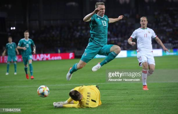 Lukas Klostermann of Germany avoids a challenge from Belarus goalkeeper Aleksandr Gutor during the UEFA Euro 2020 qualifier match between Belarus and...