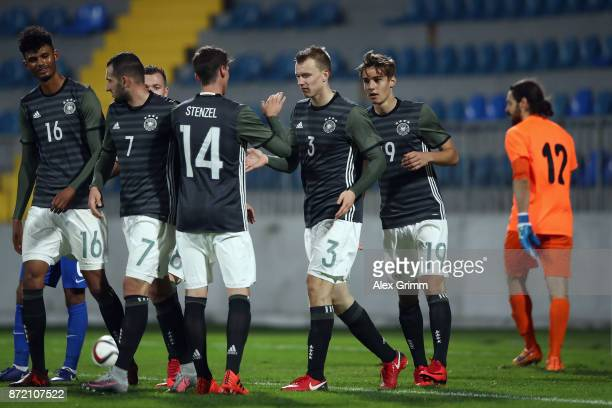 Lukas Klostermann of Germany celebrates his team's sixth goal with team mates during the UEFA Under21 Euro 2019 Qualifier match between Azerbaijan...