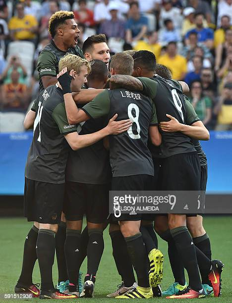 Lukas Klostermann of Germany celebrates with teammates his goal scored against Nigeria during the Rio 2016 Olympic Games mens semifinal football...
