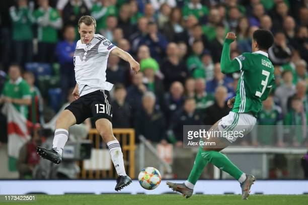 Lukas Klostermann of Germany challenges for the ball with Jamal Lewis of Northern Ireland during the UEFA Euro 2020 qualifier match between Northern...