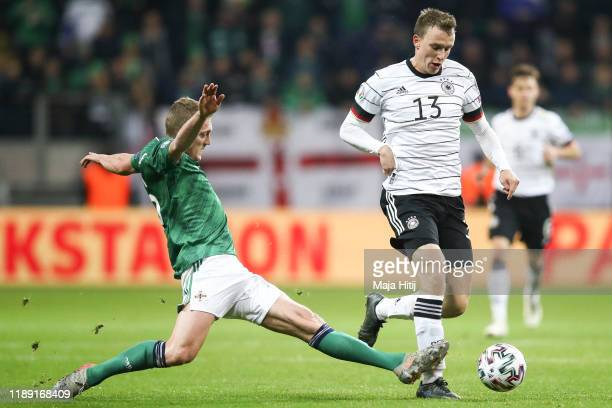 Lukas Klostermann of Germany is challenged by George Saville of Northern Ireland during the UEFA Euro 2020 Qualifier between Germany and Northern...