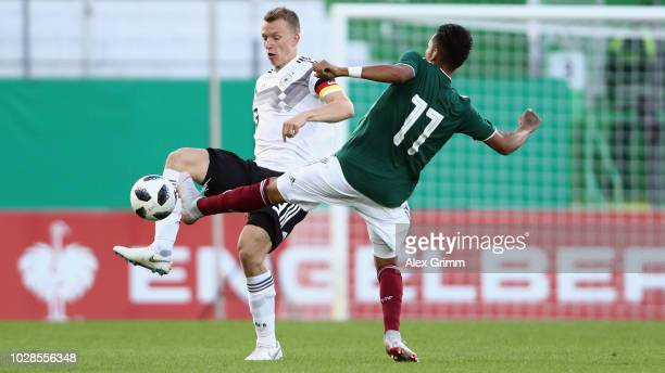 Lukas Klostermann of Germany is challenged by Ulises Cardona of Mexico during the International Friendly match between Germany U21 and Mexico U21 at...