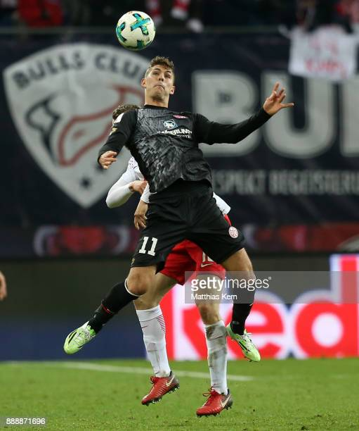 Lukas Klostermann of Leipzig and Emil Berggreen of Mainz jump for a header during the Bundesliga match between RB Leipzig and 1FSV Mainz 05 at Red...
