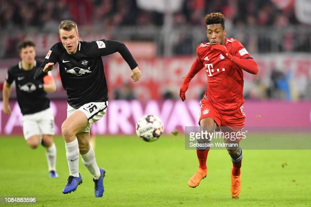 Lukas Klostermann of Leipzig and Kingsley Coman of Bayern Munich compete for the ball during the Bundesliga match between FC Bayern Muenchen and RB...
