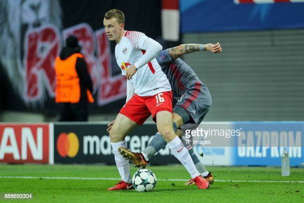Lukas Klostermann of Leipzig and Álvaro Negredo of Besiktas battle for the ball during the UEFA Champions League group G soccer match between RB...
