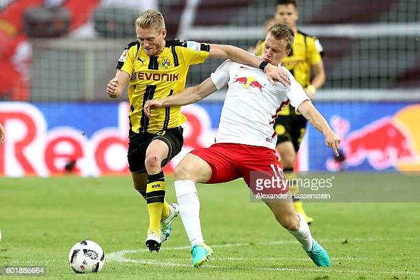 Lukas Klostermann of Leipzig battles for the ball with Andre Schuerrle of Dortmund during the Bundesliga match between RB Leipzig and Borussia...